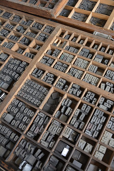 Caixa de tipos de metal
